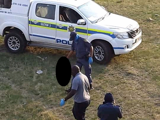 Police removing the body of the baby