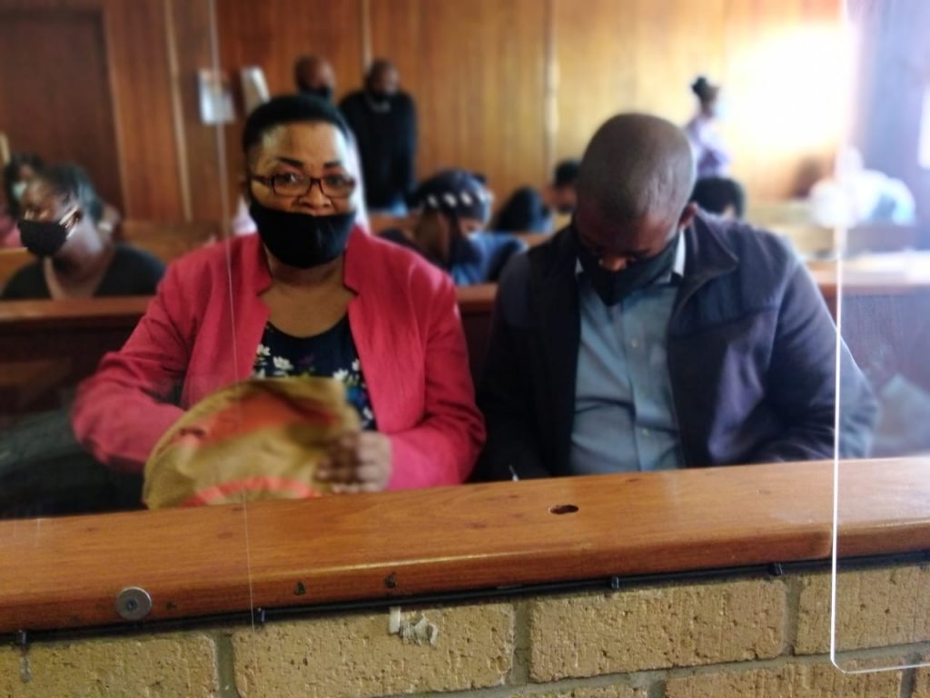fraud suspects in court